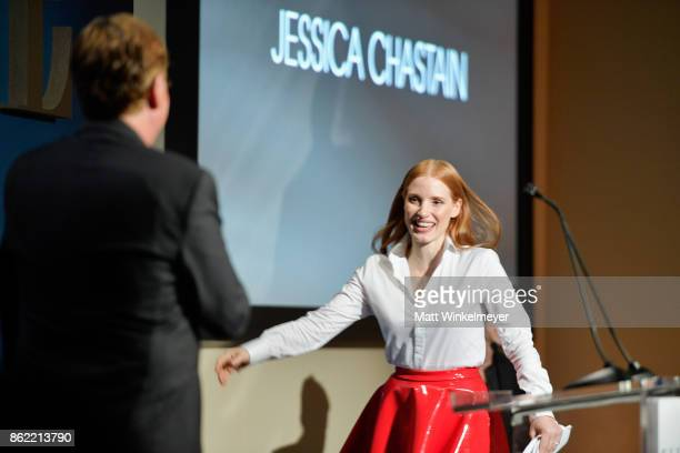 Honoree Jessica Chastain accepts award from Aaron Sorkin onstage at ELLE's 24th Annual Women in Hollywood Celebration presented by L'Oreal Paris Real...