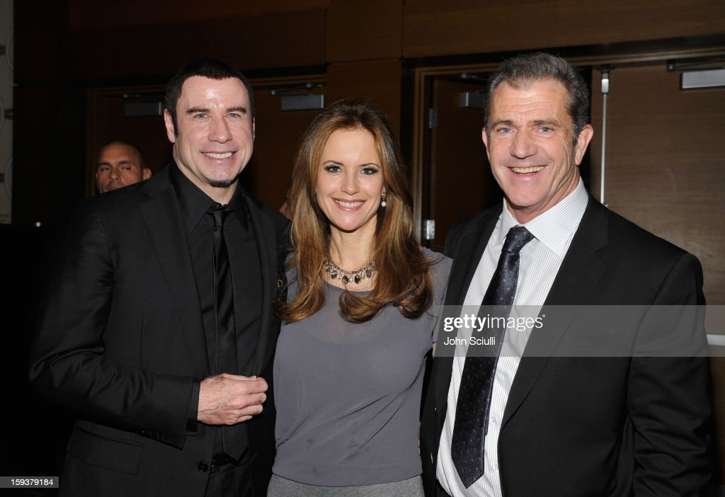 Honoree John Travolta, actors Kelly Preston and Mel Gibson attend the 2013 G'Day USA Los Angeles Black Tie Gala at JW Marriott Los Angeles at L.A. LIVE on January 12, 2013 in Los Angeles, California.