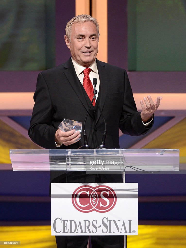Honoree Johnny Buss speaks at the podium at the 28th Anniversary Sports Spectacular Gala at the Hyatt Regency Century Plaza on May 19, 2013 in Century City, California..
