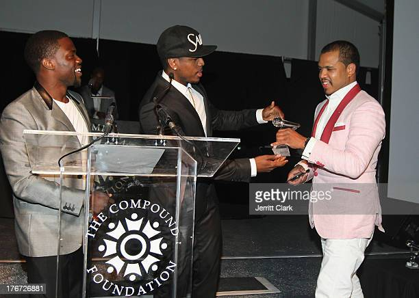 Honoree Johnny Nunez receives an award from Kevin Hart and NeYo at the 2nd annual Compound Foundation Fostering A Legacy Benefit on August 17 2013 in...