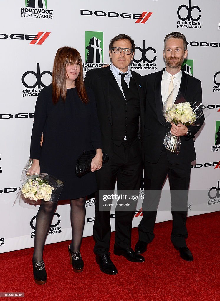Honoree Judy Becker, director David O. Russell, and honoree Michael Wilkinson arrive at the 17th annual Hollywood Film Awards at The Beverly Hilton Hotel on October 21, 2013 in Beverly Hills, California.
