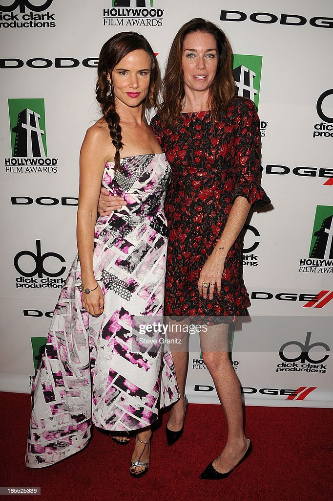 Honoree Juliette Lewis (L) and Julianne Nicholson pose in the press room during the 17th Annual Hollywood Film Awards at The Beverly Hilton Hotel on October 21, 2013 in Beverly Hills, California.