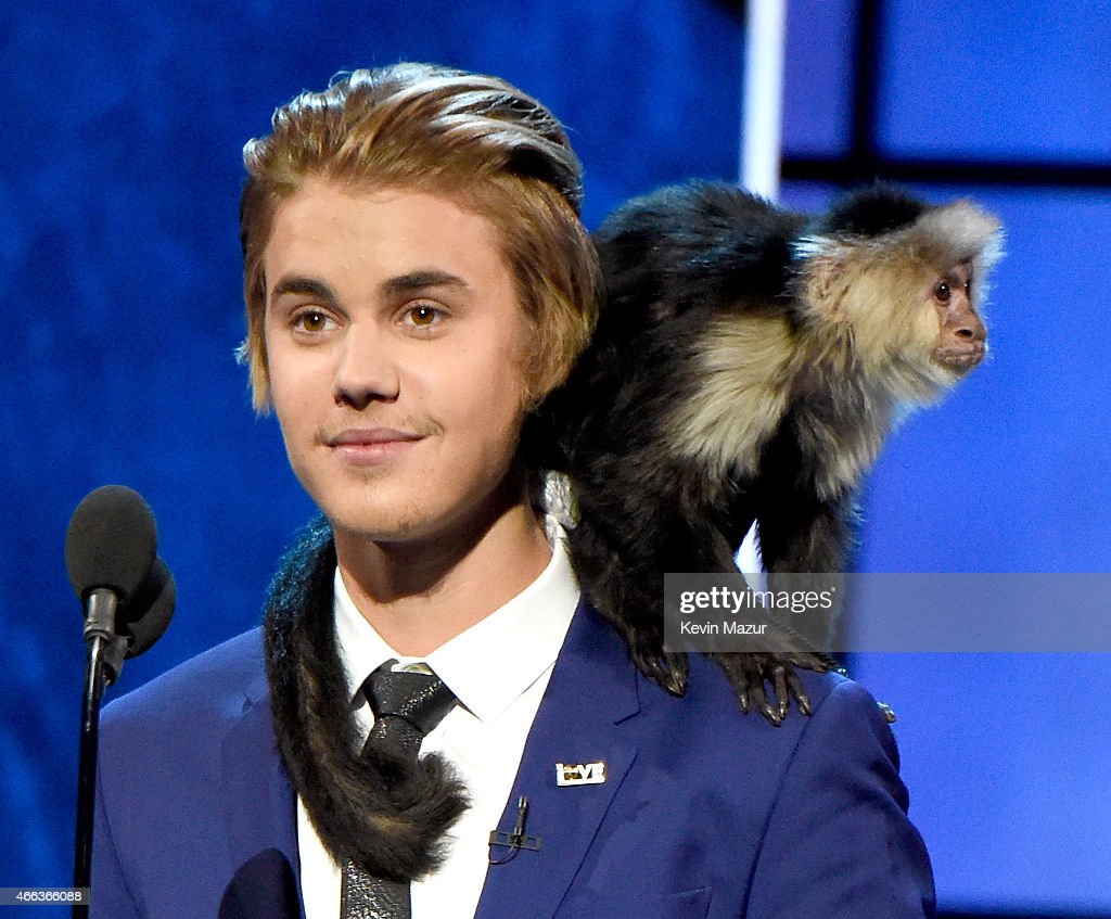 Honoree Justin Bieber and his monkey speak onstage at The Comedy Central Roast of Justin Bieber at Sony Pictures Studios on March 14, 2015 in Los Angeles, California. The Comedy Central Roast of Justin Bieber will air on March 30, 2015 at 10:00 p.m. ET/PT.