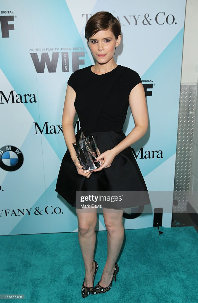 Honoree Kate Mara winner of the WIF Max Mara Face of the Future Award poses backstage at the Women In Film 2015 Crystal Lucy Awards Presented by Max...