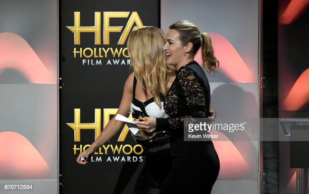 Honoree Kate Winslet walks offstage after accepting the Hollywood Actress Award for 'Wonder Wheel' with actor Shailene Woodley onstage during the...