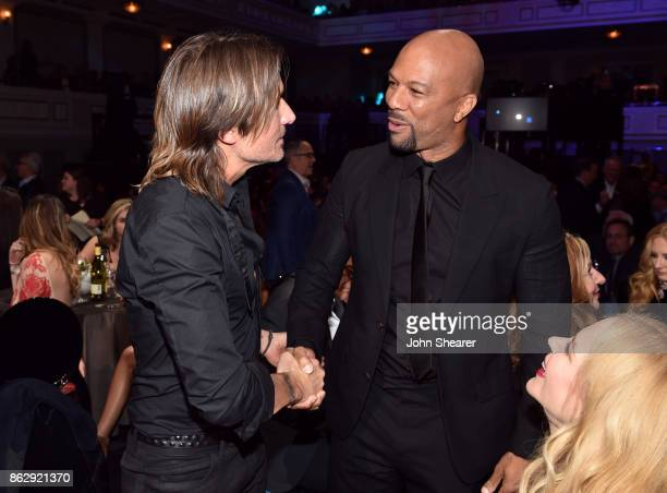 Honoree Keith Urban and singersongwriter Common take photos at the 2017 CMT Artists Of The Year on October 18 2017 in Nashville Tennessee