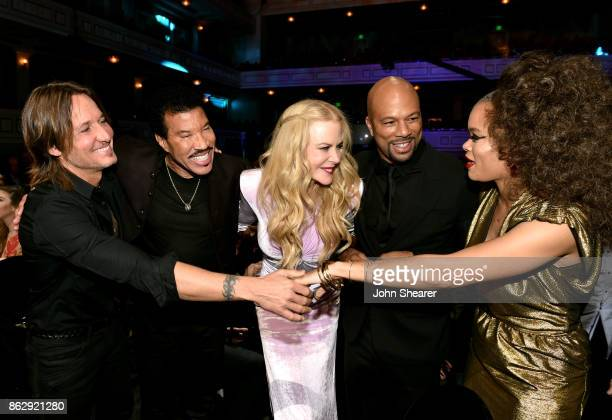 Honoree Keith Urban singersongwriter Lionel Richie actress Nicole Kidman singersongwriter Common and singersongwriter Andra Day take photos at the...
