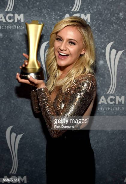 Honoree Kelsea Ballerini poses with the Gene Weed Milestone Award backstage during the 11th Annual ACM Honors at the Ryman Auditorium on August 23...