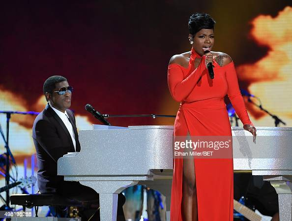 Honoree Kenneth 'Babyface' Edmonds and recording artist Fantasia Barrino perform during the 2015 Soul Train Music Awards at the Orleans Arena on...