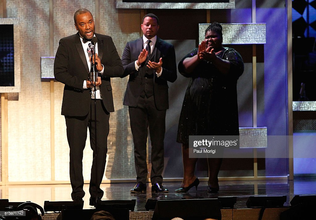 Honoree Lee Daniels accepts an award from actors Terrence Howard and Gabourey Sidibe on stage during the BET Honors 2016 Show at Warner Theatre on...