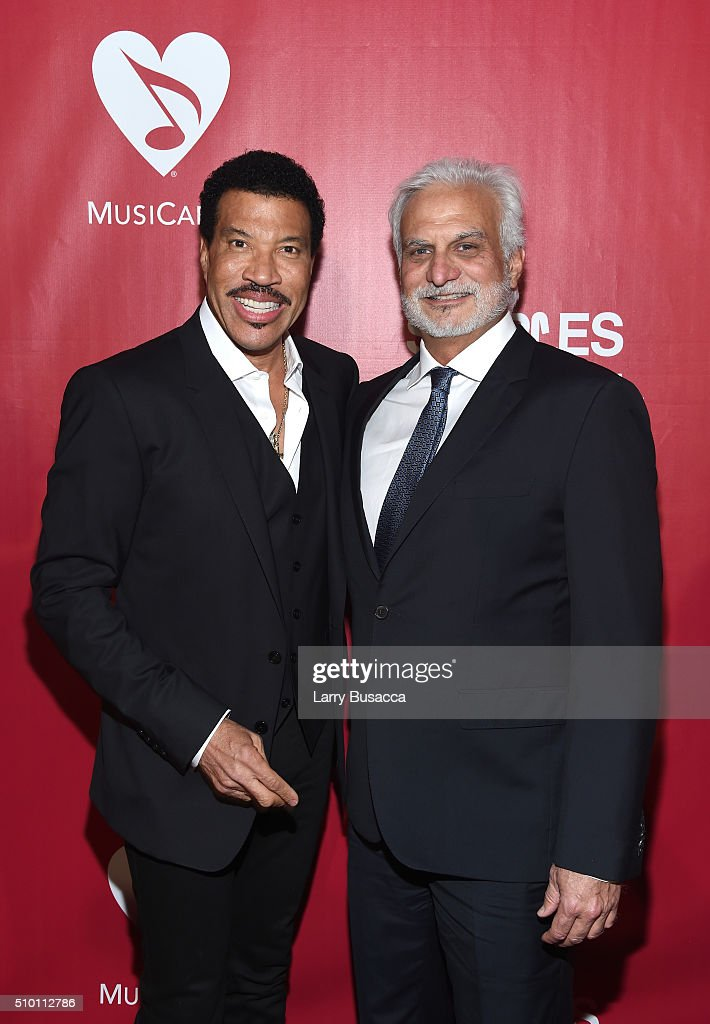 Honoree Lionel Richie (L) and chair of the MusiCares Foundation Board Bill Silva attend the 2016 MusiCares Person of the Year honoring Lionel Richie at the Los Angeles Convention Center on February 13, 2016 in Los Angeles, California.