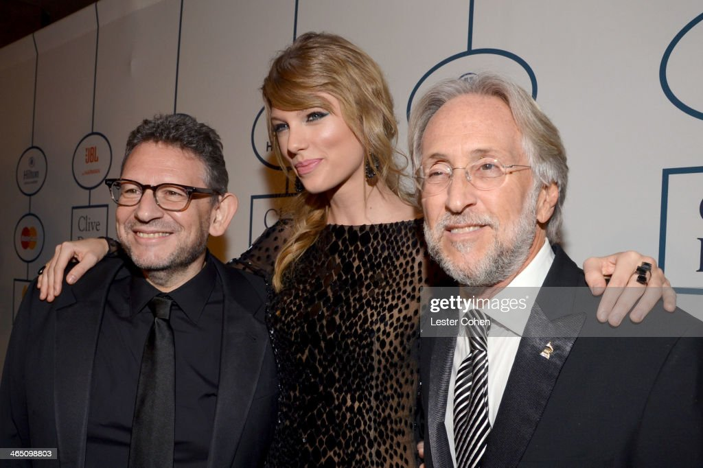 Honoree <a gi-track='captionPersonalityLinkClicked' href=/galleries/search?phrase=Lucian+Grainge&family=editorial&specificpeople=813742 ng-click='$event.stopPropagation()'>Lucian Grainge</a>, singer <a gi-track='captionPersonalityLinkClicked' href=/galleries/search?phrase=Taylor+Swift&family=editorial&specificpeople=619504 ng-click='$event.stopPropagation()'>Taylor Swift</a>, and Recording Academy President/CEO <a gi-track='captionPersonalityLinkClicked' href=/galleries/search?phrase=Neil+Portnow&family=editorial&specificpeople=208909 ng-click='$event.stopPropagation()'>Neil Portnow</a> attend the 56th annual GRAMMY Awards Pre-GRAMMY Gala and Salute to Industry Icons honoring <a gi-track='captionPersonalityLinkClicked' href=/galleries/search?phrase=Lucian+Grainge&family=editorial&specificpeople=813742 ng-click='$event.stopPropagation()'>Lucian Grainge</a> at The Beverly Hilton on January 25, 2014 in Los Angeles, California.