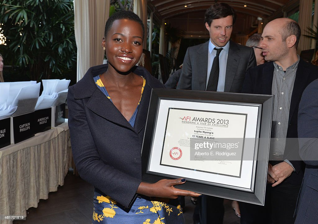 Honoree <a gi-track='captionPersonalityLinkClicked' href=/galleries/search?phrase=Lupita+Nyong%27o&family=editorial&specificpeople=10961876 ng-click='$event.stopPropagation()'>Lupita Nyong'o</a> attends the 14th annual AFI Awards Luncheon at the Four Seasons Hotel Beverly Hills on January 10, 2014 in Beverly Hills, California.