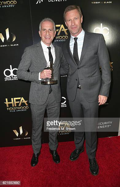 Honoree Marc Platt Hollywood Producer Award recipient and actor Aaron Eckhart pose in the press room at the 20th Annual Hollywood Film Awards at The...