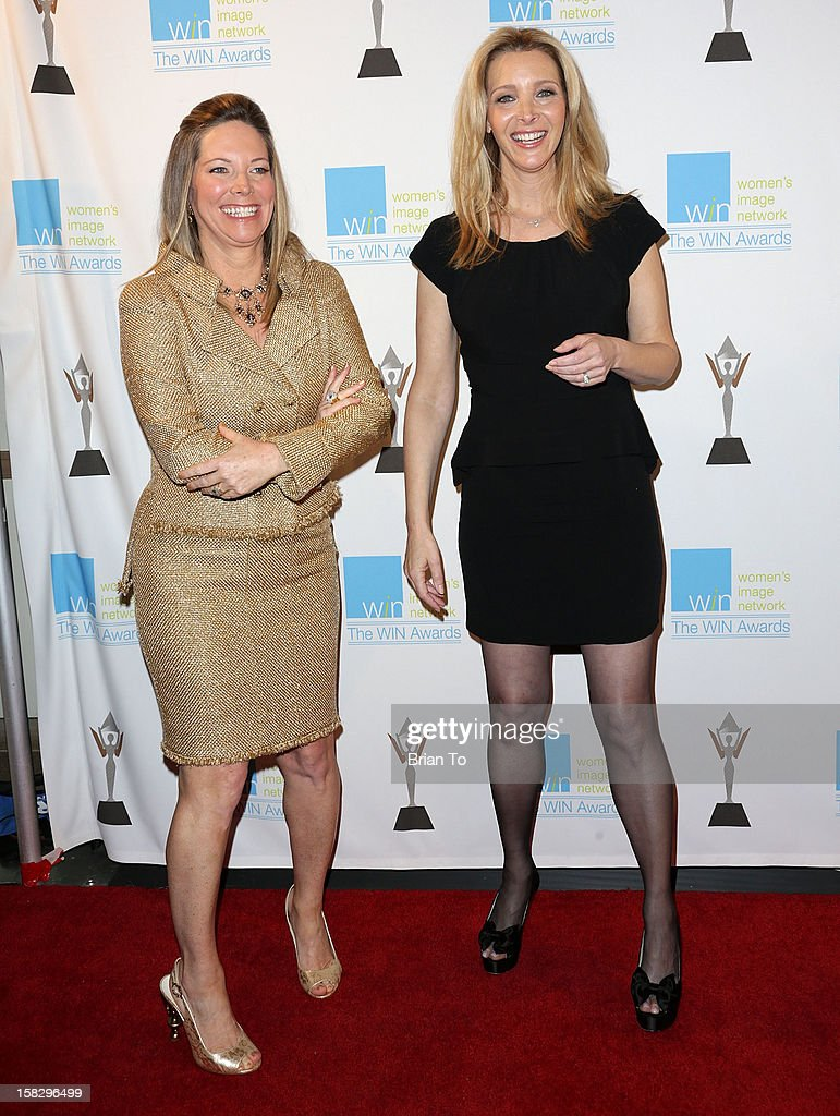 Honoree Maria Arena Bell, former head writer and executive producer of the CBS Daytime soap opera The Young and the Restless, and actress <a gi-track='captionPersonalityLinkClicked' href=/galleries/search?phrase=Lisa+Kudrow&family=editorial&specificpeople=202079 ng-click='$event.stopPropagation()'>Lisa Kudrow</a> attend The 14th a annual Women's Image Network (WIN) awards at Paramount Theater on the Paramount Studios lot on December 12, 2012 in Hollywood, California.