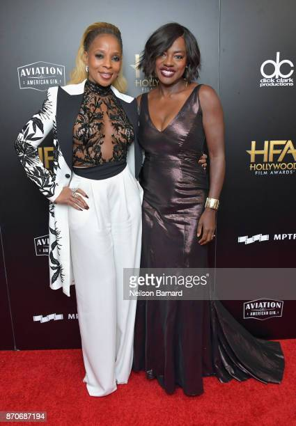 Honoree Mary J Blige recipient of the Hollywood Breakout Performance Actress Award for 'Mudbound' and actor Viola Davis pose in the press room during...