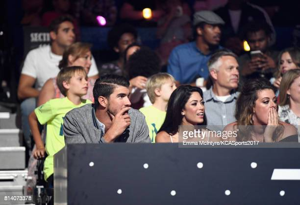 Honoree Michael Phelps and modelMiss California USA 2010 Nicole Johnson attend Nickelodeon Kids' Choice Sports Awards 2017 at Pauley Pavilion on July...