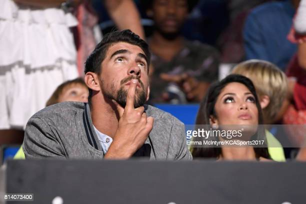 Honoree Michael Phelps and modelMiss California USA 2010 Nicole Johnson during Nickelodeon Kids' Choice Sports Awards 2017 at Pauley Pavilion on July...