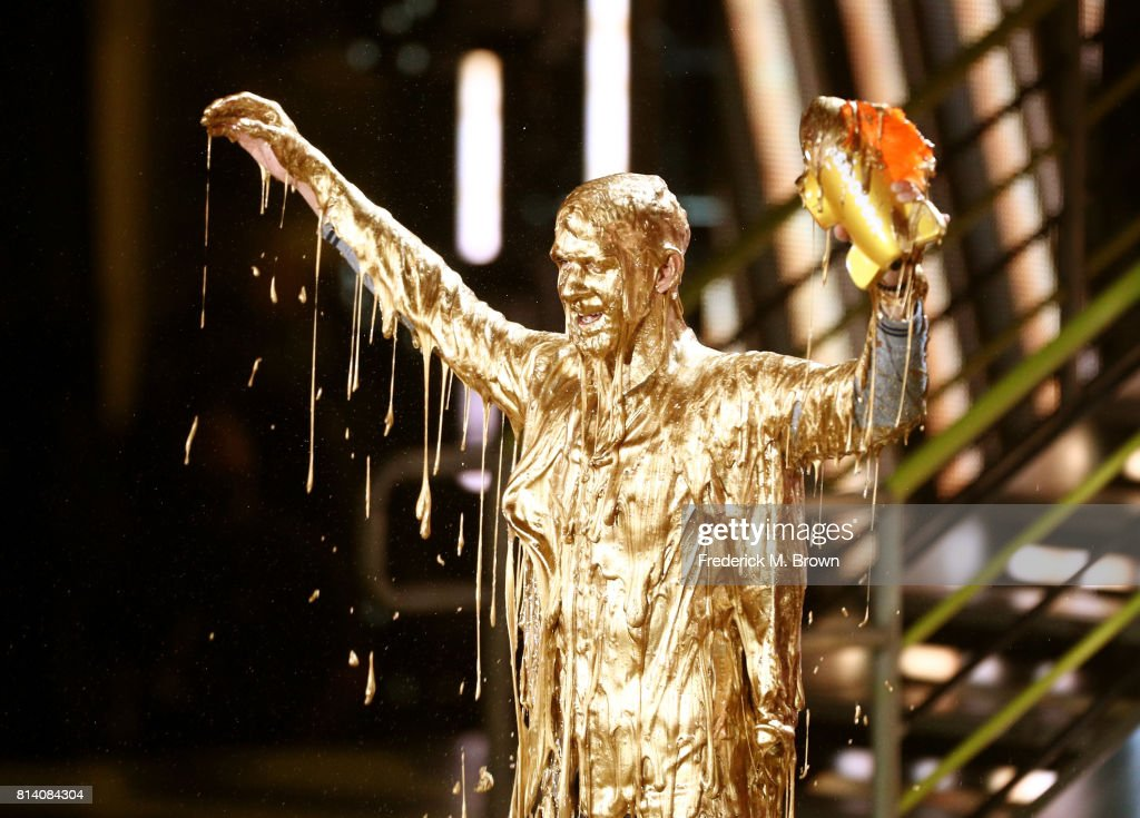 Honoree Michael Phelps reacts after getting slimed while accepting the Legend Award onstage during Nickelodeon Kids' Choice Sports Awards 2017 at Pauley Pavilion on July 13, 2017 in Los Angeles, California.