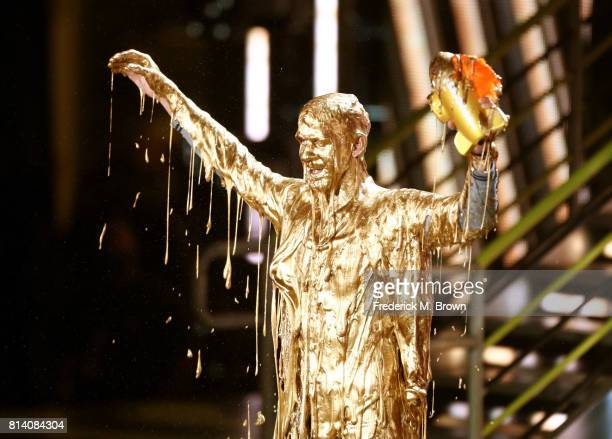 Honoree Michael Phelps reacts after getting slimed while accepting the Legend Award onstage during Nickelodeon Kids' Choice Sports Awards 2017 at...