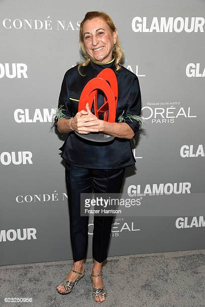 Honoree Miuccia Prada poses with an award during Glamour Women Of The Year 2016 at NeueHouse Hollywood on November 14 2016 in Los Angeles California