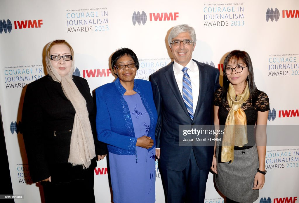 Honoree Najiba Ayubi, Lifetime Achievement Award winner Edna Machirori, IWMF co-chair Theodore J. Boutrous Jr. and honoree Bopha Phorn attend the International Women's Media Foundation's 2013 Courage in Journalism Awards at the Beverly Hills Hotel on October 29, 2013 in Beverly Hills, California.