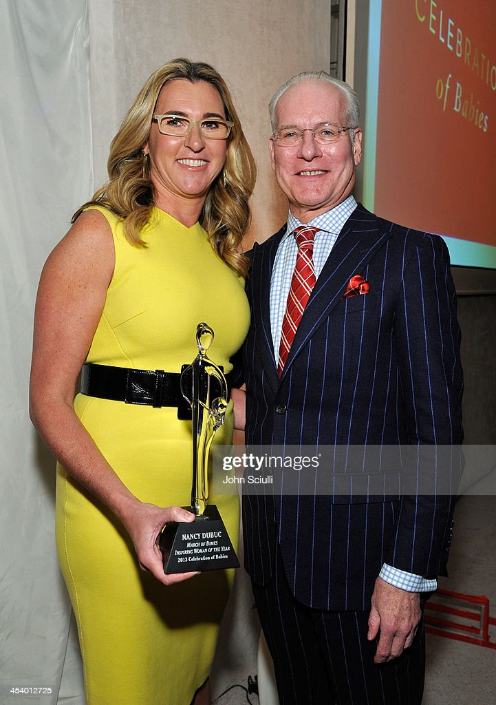 Honoree Nancy Dubuc, holding the March of Dimes 2013 Inspiring Woman of the Year Award, poses with TV personality <a gi-track='captionPersonalityLinkClicked' href=/galleries/search?phrase=Tim+Gunn&family=editorial&specificpeople=696109 ng-click='$event.stopPropagation()'>Tim Gunn</a> at the March of Dimes Celebration of Babies Luncheon at Beverly Hills Hotel on December 6, 2013 in Beverly Hills, California.