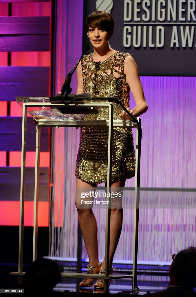 Honoree of LACOSTE Spotlight Award <a gi-track='captionPersonalityLinkClicked' href=/galleries/search?phrase=Anne+Hathaway+-+Actress&family=editorial&specificpeople=11647173 ng-click='$event.stopPropagation()'>Anne Hathaway</a> speaks onstage during the 15th Annual Costume Designers Guild Awards with presenting sponsor Lacoste at The Beverly Hilton Hotel on February 19, 2013 in Beverly Hills, California.