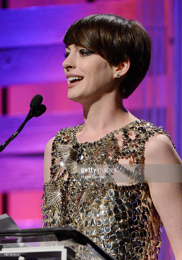 Honoree of LACOSTE Spotlight Award Anne Hathaway speaks onstage during the 15th Annual Costume Designers Guild Awards with presenting sponsor Lacoste at The Beverly Hilton Hotel on February 19, 2013 in Beverly Hills, California.
