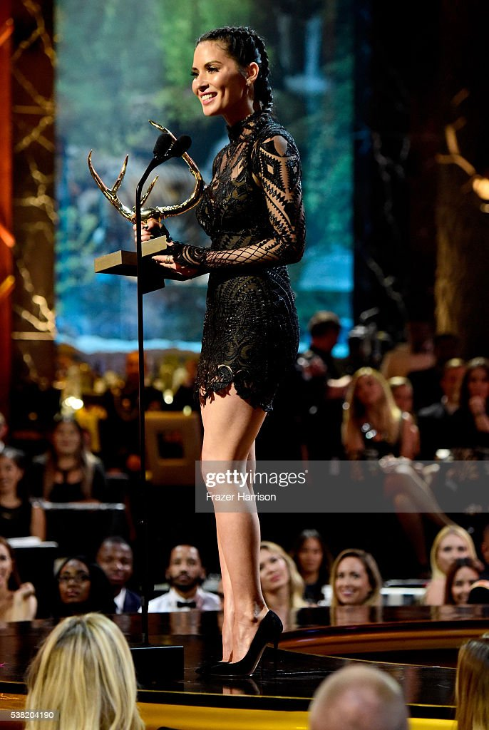 Honoree Olivia Munn accepts the Jean Claude Gahd Dam Award onstage during Spike TV's 10th Annual Guys Choice Awards at Sony Pictures Studios on June 4, 2016 in Culver City, California.