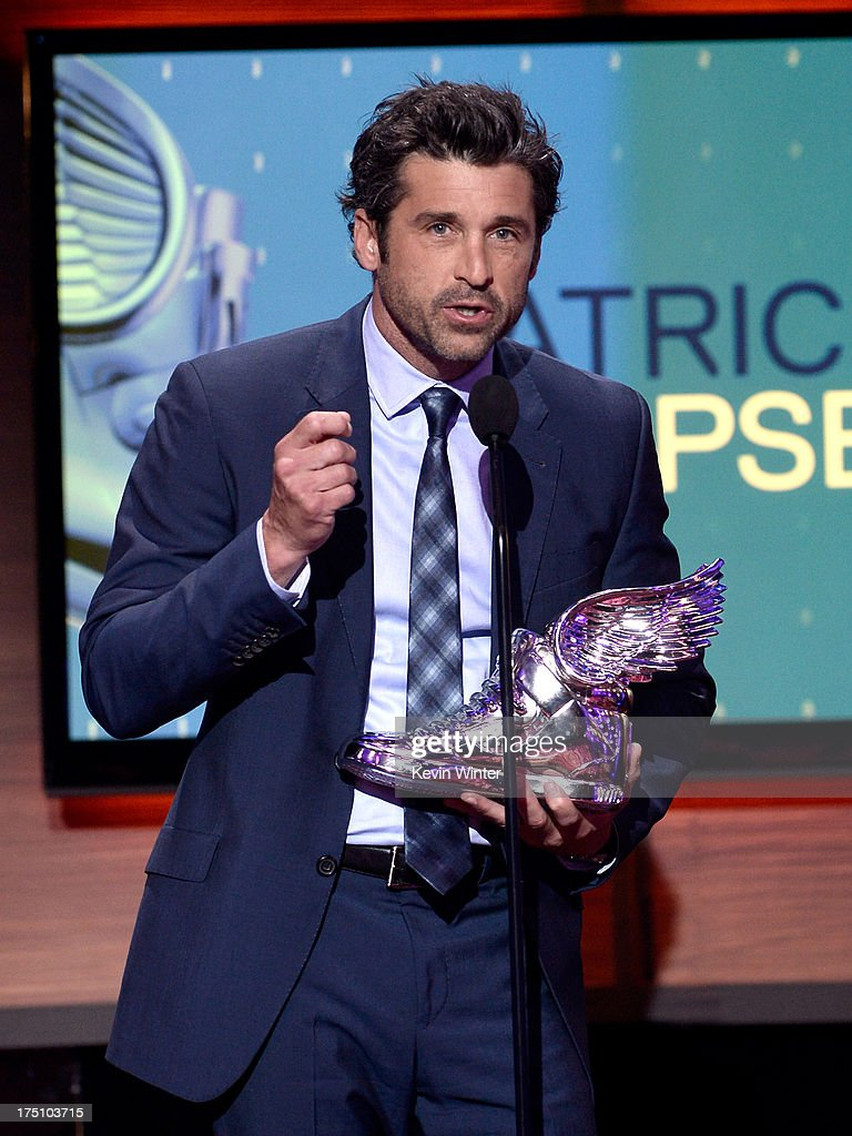 Honoree <a gi-track='captionPersonalityLinkClicked' href=/galleries/search?phrase=Patrick+Dempsey&family=editorial&specificpeople=241264 ng-click='$event.stopPropagation()'>Patrick Dempsey</a> speaks onstage at the DoSomething.org and VH1's 2013 Do Something Awards at Avalon on July 31, 2013 in Hollywood, California.