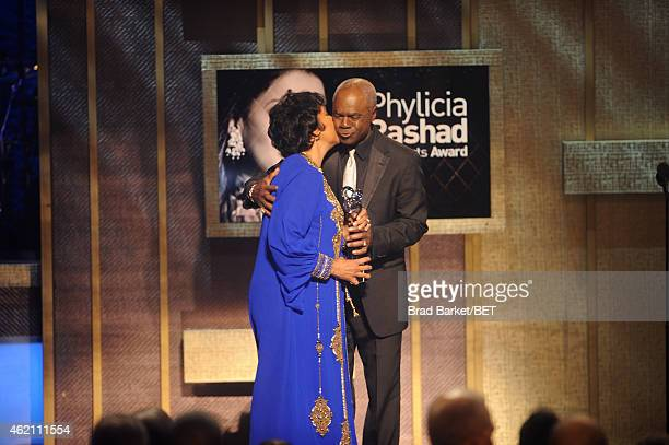 Honoree Phylicia Rashad and Actor Glynn Turman embrace onstage during 'The BET Honors' 2015 at Warner Theatre on January 24 2015 in Washington DC