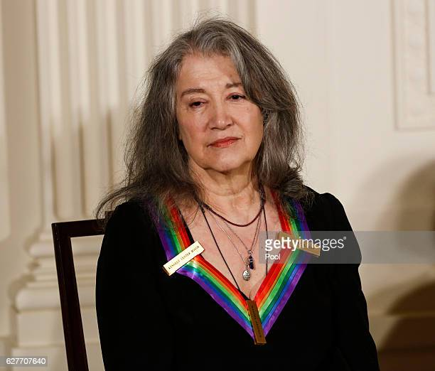 Honoree pianist Martha Argerich listens to President Barack Obama during a ceremony for the 2016 Kennedy Center honorees December 4 2016 in the East...