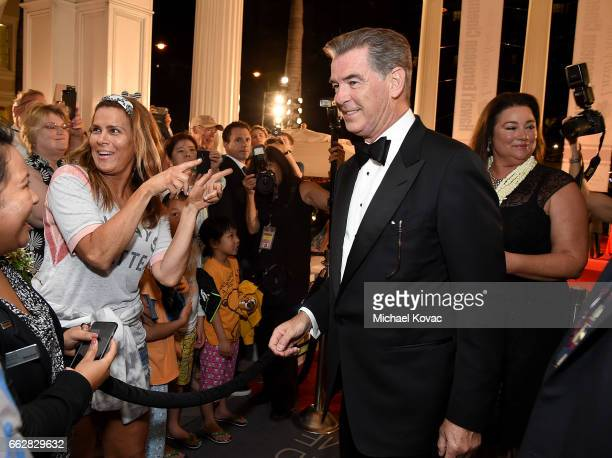 Honoree Pierce Brosnan poses with fans at the 8th Annual Hawaii European Cinema Film Festival Gala at Moana Surfrider on March 31 2017 in Honolulu...
