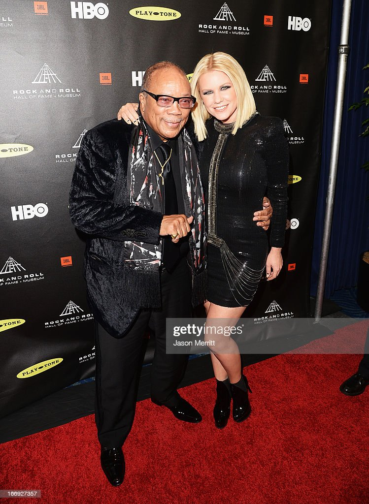 Honoree Quincy Jones and tv personality Carrie Keagan arrive at the 28th Annual Rock and Roll Hall of Fame Induction Ceremony at Nokia Theatre L.A. Live on April 18, 2013 in Los Angeles, California.