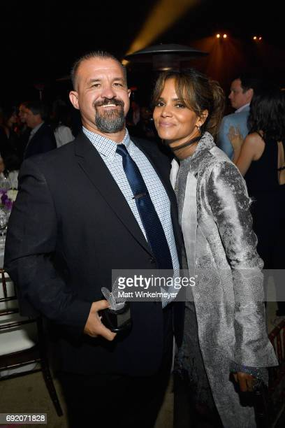 Honoree Raymond Davis and Actor Halle Berry at the 16th Annual Chrysalis Butterfly Ball on June 3 2017 in Los Angeles California