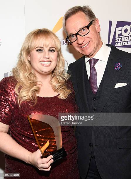 Honoree Rebel Wilson and director Paul Feig pose with the Screen NSW Kellermann Award during Australians In Film's 5th Annual Awards Gala at...