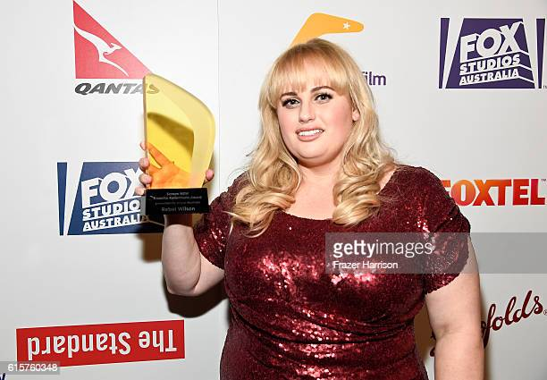 Honoree Rebel Wilson poses with the Screen NSW Kellermann Award during Australians In Film's 5th Annual Awards Gala at NeueHouse Hollywood on October...