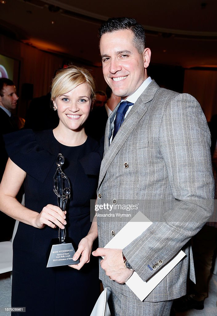 Honoree <a gi-track='captionPersonalityLinkClicked' href=/galleries/search?phrase=Reese+Witherspoon&family=editorial&specificpeople=201577 ng-click='$event.stopPropagation()'>Reese Witherspoon</a> and actor <a gi-track='captionPersonalityLinkClicked' href=/galleries/search?phrase=Jim+Toth&family=editorial&specificpeople=4543295 ng-click='$event.stopPropagation()'>Jim Toth</a> pose with the Grace Kelly Award during the 7th Annual March of Dimes Celebration of Babies, a Hollywood Luncheon, at the Beverly Hills Hotel on December 7, 2012 in Beverly Hills, California.