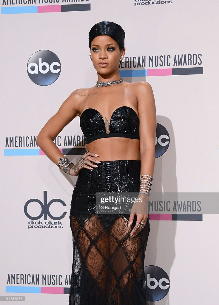 Honoree Rihanna, recipient of the Icon Award and winner of the Favorite Female Artist - Soul/R&B award, poses in the press room at the 2013 American Music Awards at Nokia Theatre L.A. Live on November 24, 2013 in Los Angeles, California.