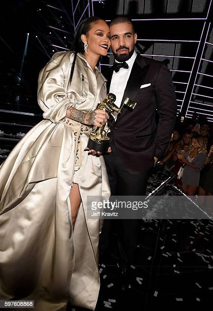 Honoree Rihanna winner of the Michael Jackson Video Vanguard Award and recording artist Drake onstage during the 2016 MTV Video Music Awards at...