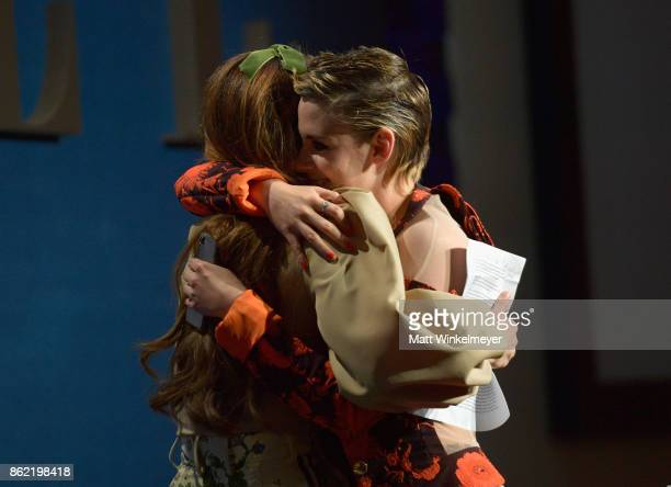 Honoree Riley Keough accepts award from Kristen Stewart onstage at ELLE's 24th Annual Women in Hollywood Celebration presented by L'Oreal Paris Real...