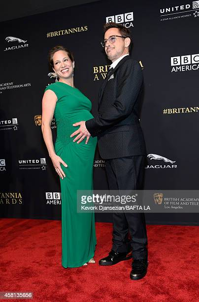 Honoree Robert Downey Jr and producer Susan Downey attend the 2014 BAFTA Los Angeles Jaguar Britannia Awards Presented By BBC America And United...