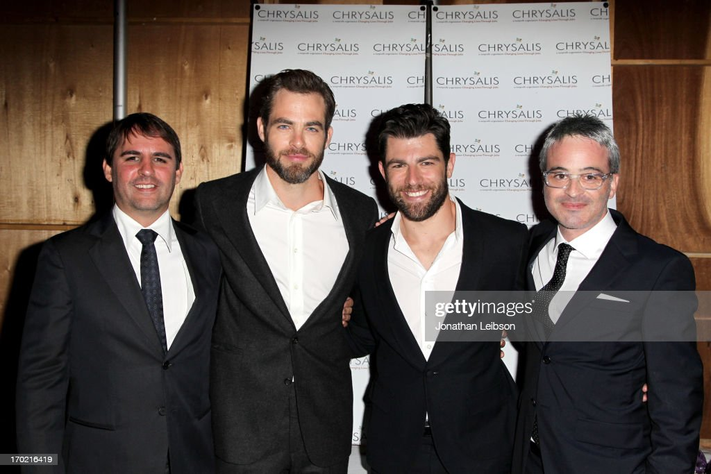Honoree Roberto Orci, actor Chris Pine, host Max Greenfield, and honoree Alex Kurtzman attend the 12th Annual Chrysalis Butterfly Ball on June 8, 2013 in Los Angeles, California.