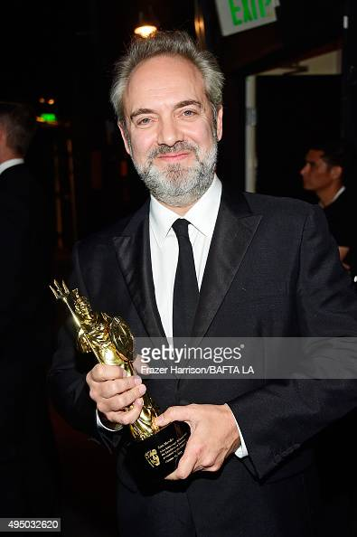 Honoree Sam Mendes poses with the John Schlesinger Britannia Award for Excellence in Directing presented by The GREAT Britain Campaign during the...