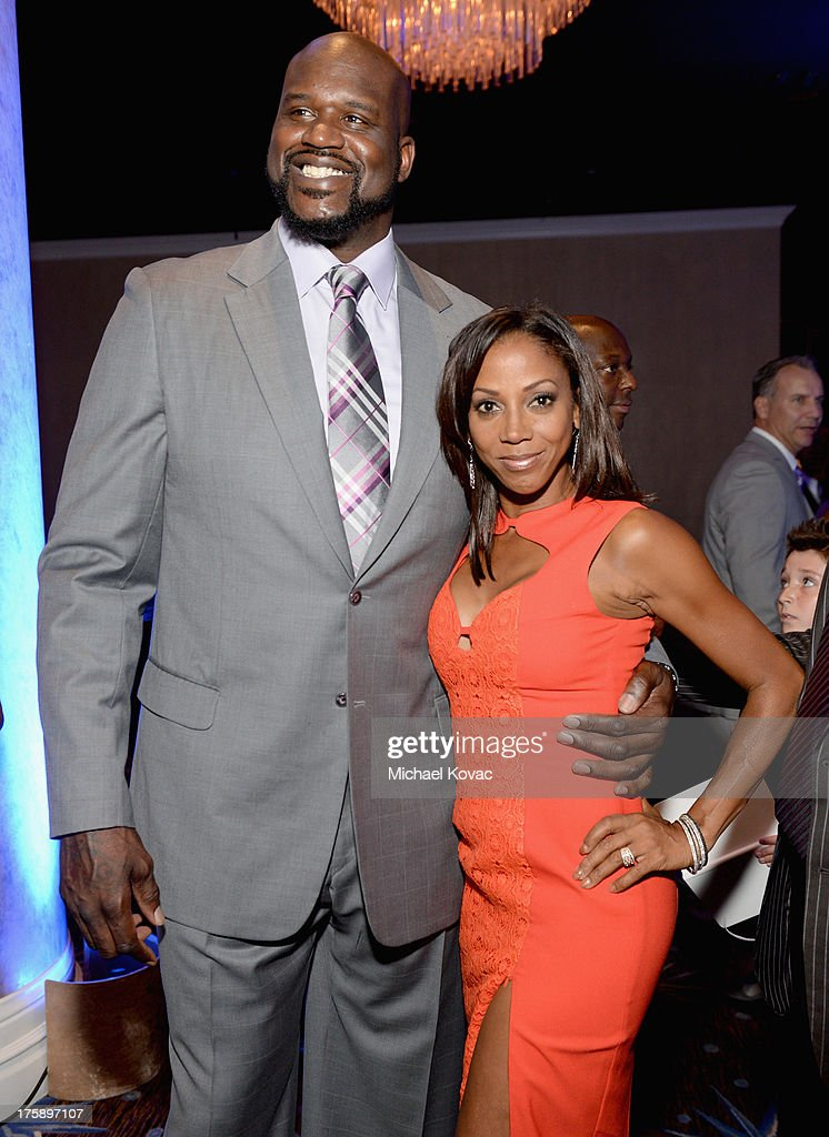 Honoree Shaquille O'Neal and actress Holly Robinson Peete attend the 13th Annual Harold And Carole Pump Foundation Gala Honoring Jamie Foxx, Shaquille O'Neal, And Joe Torre at The Beverly Hilton Hotel on August 9, 2013 in Beverly Hills, California.