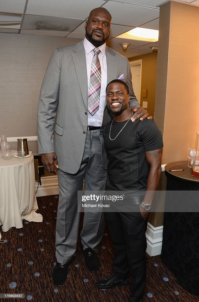 Honoree Shaquille O'Neal and comedian Kevin Hart attend the 13th Annual Harold And Carole Pump Foundation Gala Honoring Jamie Foxx, Shaquille O'Neal, And Joe Torre at The Beverly Hilton Hotel on August 9, 2013 in Beverly Hills, California.