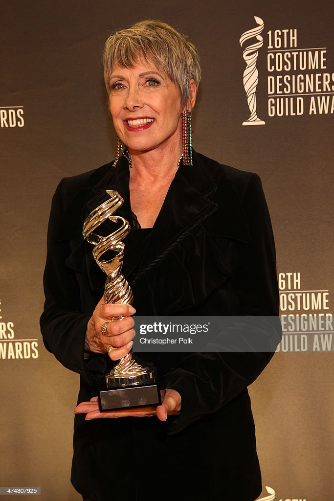 Honoree Sharon Day poses with the Service Award during the 16th Costume Designers Guild Awards with presenting sponsor Lacoste at The Beverly Hilton Hotel on February 22, 2014 in Beverly Hills, California.