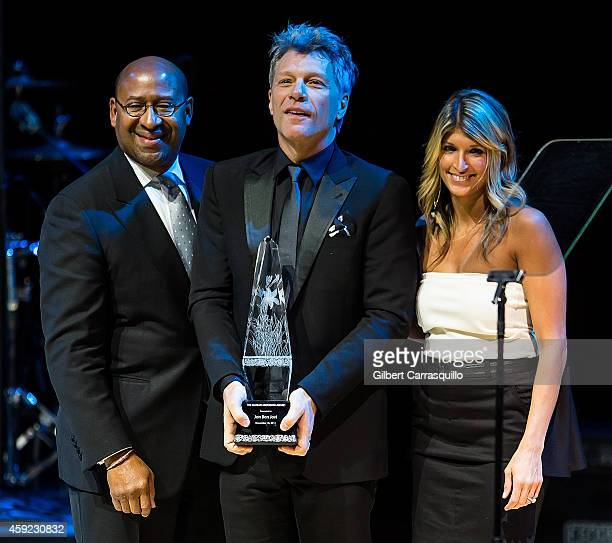Honoree singer Jon Bon Jovi accepts the 2014 Marian Anderson Award from Philadelphia Mayor Michael Nutter and Board Chair Nina C Tinari at Kimmel...