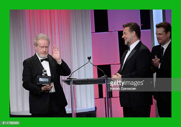 Honoree Sir Ridley Scott accepts the American Cinematheque Award from actors Russell Crowe and Matt Damon onstage at the 30th Annual American...